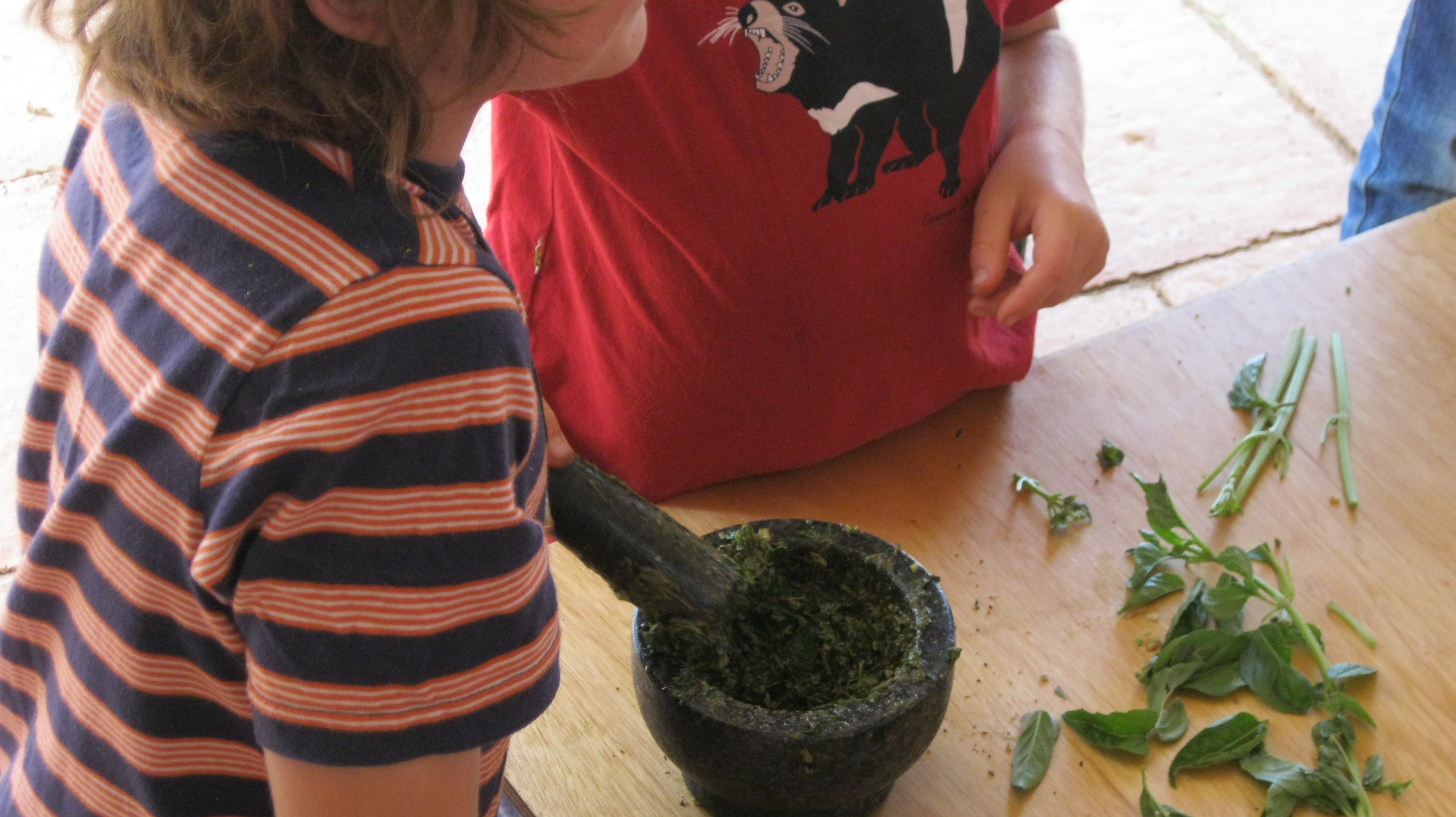 crushing the basil with oil